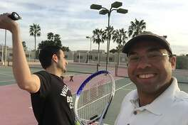 Farhan Zaidi, right, poses for a photo with his brother, Jaffer, before playing a tennis match in Arizona in 2015. The two play tennis every year during baseball's spring training. On this visit, Jaffer was diagnosed with cancer, but they still played their match.