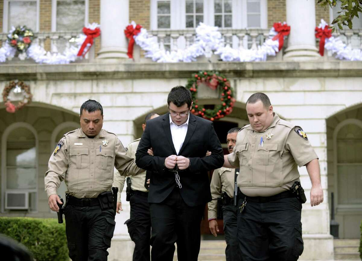 Jack Dillon Young, the driver of the truck that slammed into a church bus and killed 13 people returning from a church retreat in 2017, is escorted by Uvalde County Sheriff's deputies from the courthouse where his sentencing hearing is being held on Friday, Nov. 9, 2018.