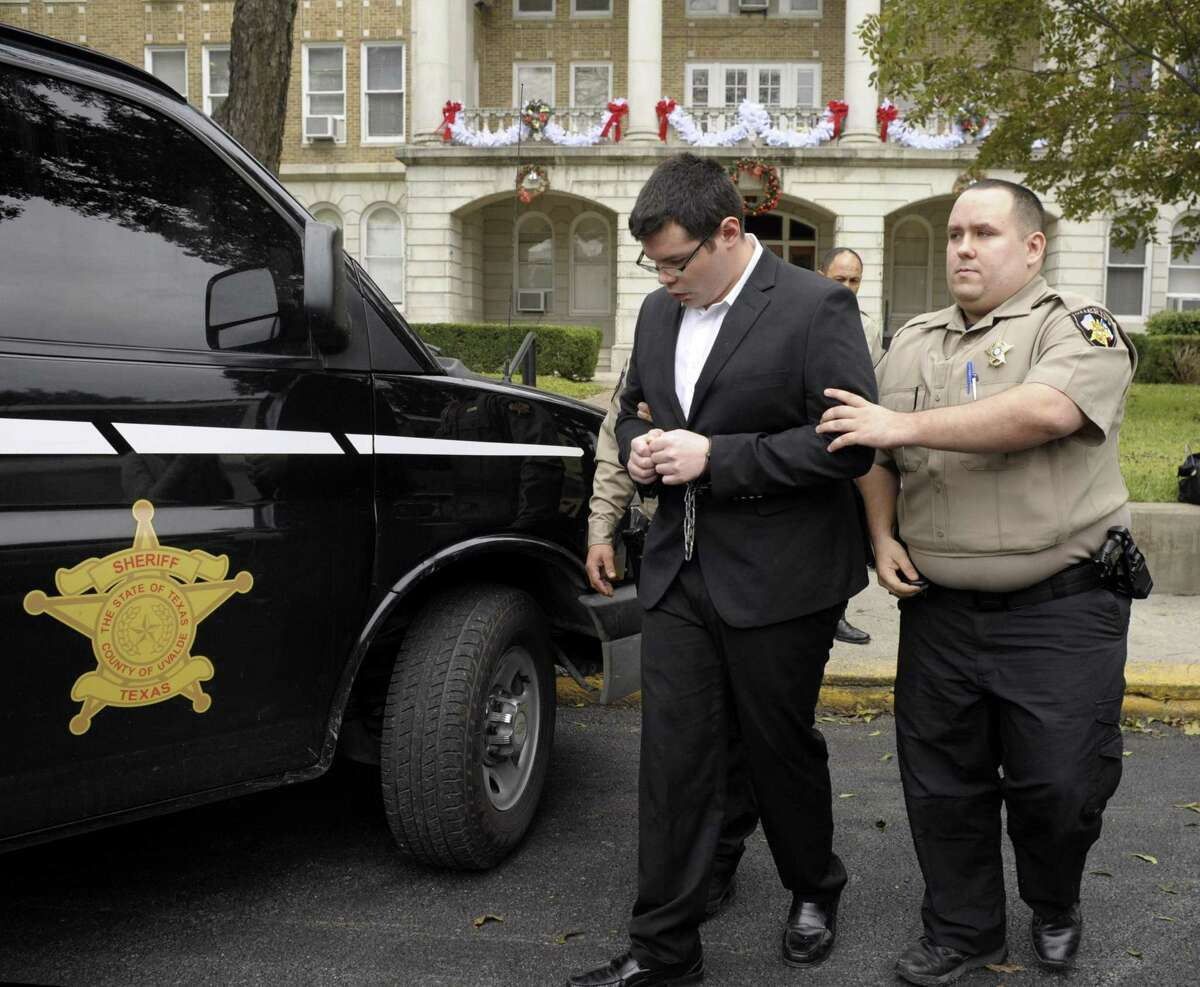 Jack Dillon Young, the driver of the truck that slammed into a bus and killed 13 people returning from a church retreat in March 2017, is led into a vehicle during a break at his sentencing hearing in Uvalde on Friday, Nov. 9, 2018.