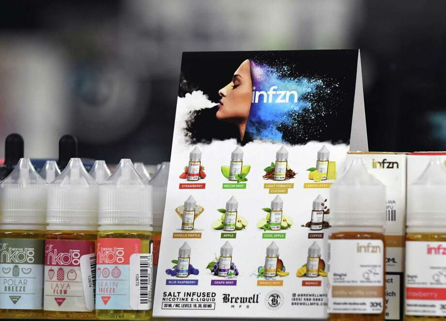 Flavored e-liquids are displayed at Exscape Smoke Shop on Friday, Nov. 9, 2018, on Western Ave. in Albany, N.Y.  New York's Department of Health has rescinded proposed regulations seeking to ban flavored e-cigarettes and e-liquids, after industry insiders raised concerns over the legality of such an action. (Will Waldron/Times Union) Photo: Will Waldron, Albany Times Union / 20045447A