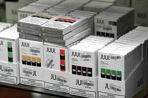 JUUL electronic cigarettes are displayed at Exscape Smoke Shop on Friday, Nov. 9, 2018, on Western Ave. in Albany, N.Y. New York's Department of Health has rescinded proposed regulations seeking to ban flavored e-cigarettes and e-liquids, after industry insiders raised concerns over the legality of such an action. (Will Waldron/Times Union)