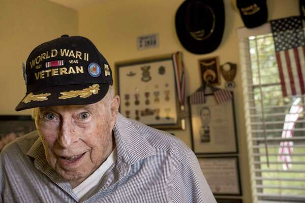 Lt. Col. Leslie Thompson, a United States Air Force veteran who served in World War II, the Korean War and the Vietnam War, poses for a portrait on Thursday, Nov. 8, in Houston. Thompson flew B-17s in Europe during World War II, flying 29 bombing missions.