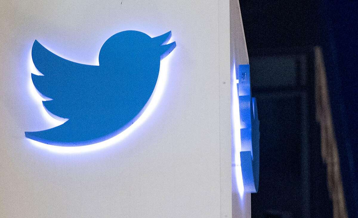 The Twitter logo is seen on a sign at the company's headquarters in San Francisco.