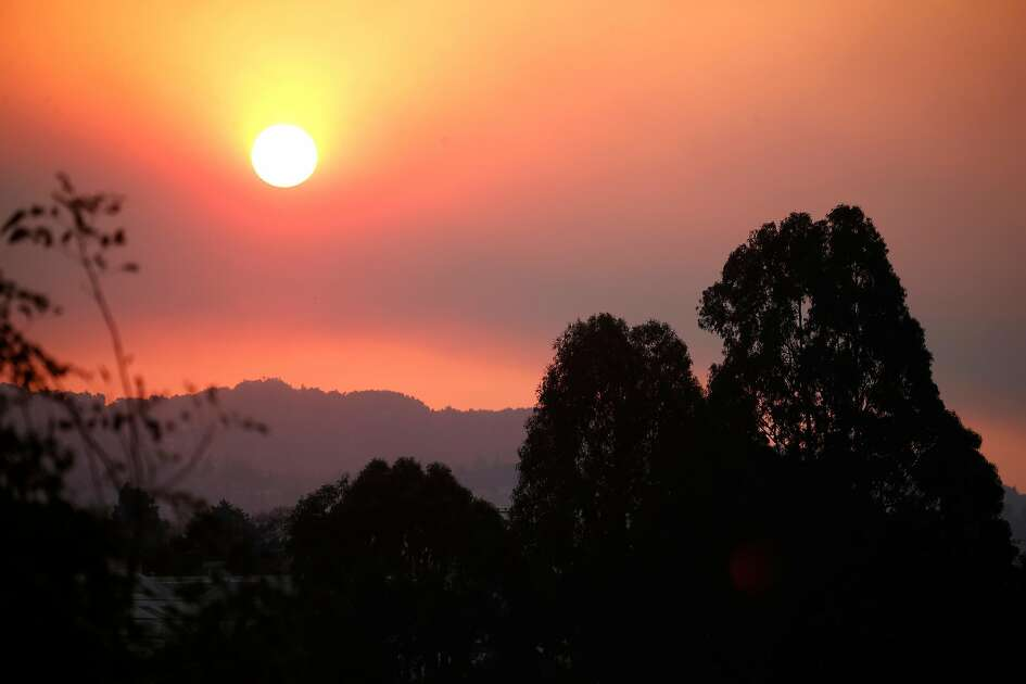 The sun rises above the East Bay hills through a smoky haze in Berkeley, Calif. on Friday, Nov. 9, 2018. Air quality in the region remains unhealthy while smoke from the Camp Fire in Butte County continues to drift to the south.