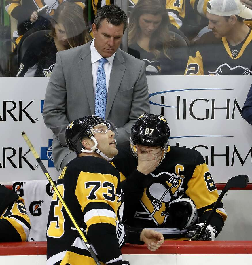 Things are not going so well with coach Mike Sullivan, forward Sidney Crosby (87), defenseman Jack Johnson (73) or the rest of the Pittsburgh Penguins. But Sullivan, who guided the Pens to two Stanley Cup titles, is likely safe. Photo: Gene J. Puskar / Associated Press