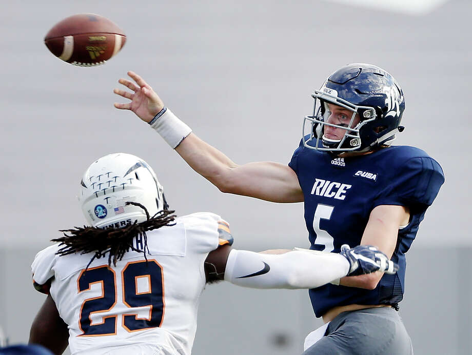 PHOTOS: College football's largest stadiums in 2018  Rice quarterback Wiley Green (5) throws the ball under pressure from UTEP linebacker Jamar Smith (29) during the second half of an NCAA college football game Saturday, Nov. 3, 2018, in Houston. (AP Photo/Michael Wyke)  >>>Browse through the photos for a look at college football's largest stadiums in 2018 ... Photo: Michael Wyke, Associated Press / © Associated Press 2018