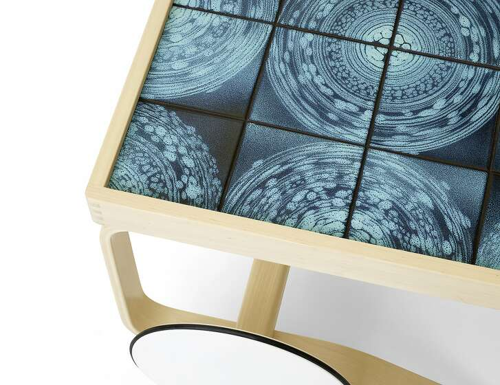 """The Bay Area's Heath Ceramics recently collaborated with Finland furniture company Artek to reimagine Alvar Aalto's legendary Stool 60 and Tea Trolley 900 for a limited-edition collection. Silkscreened over the stool's wooden top is Heath's glaze """"Universe,"""" which was developed in 2016 by Chiang and Heath master glazer Winnie Crittenden.    Heath + Artek  Tea Trolley 900 - custom glazed tiles  Limited Edition  $6800  Designed by Aino and Alvar Aalto in 1937, the Tea Trolley 900 was inspired by British tea culture as well as by the Japanese woodwork and architecture they admired. To celebrate this beloved Artek design, Heath developed a series of striking ceramic tile tops, drawing inspiration from historic designs and recent Heath Clay Studio experiments. Made in Finland, the trollies are brought to Heath SF where tiles � individually glazed, ensuring each is unique � are mounted by hand.   Orbit The Maze and Orbit tile tops are created by placing tiles on a spinning wheel. Glaze is applied with a squeeze bottle, creating concentric lines. This results in two styles: one more graphic and precise, and the other intentionally blurred.   These techniques were also inspired by vintage tile installations made by Heath, some of which are still installed in their Sausalito factory."""