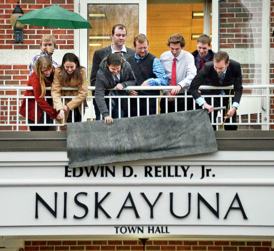 Grandchildren of former Supervisor Ed Reilly unveil the renaming of Niskayuna Town Hall in honor of their grandfather during a dedication ceremony Friday Nov. 9, 2018 in Niskayuna, NY.  (John Carl D'Annibale/Times Union) Photo: John Carl D'Annibale, Albany Times Union / 20045391A