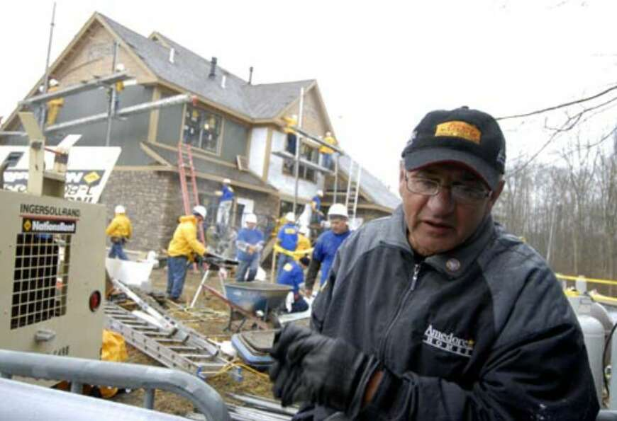 George Amedore Sr. talks about the rebuilding of Debbie Oatman's home Monday, March 26.