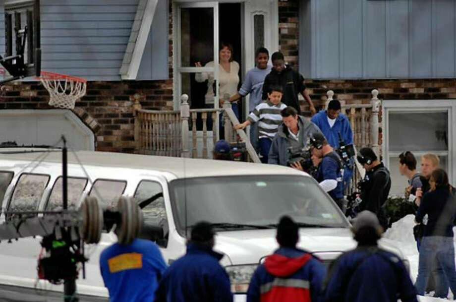 """Extreme Makeover: Home Edition"" host Ty Pennington leads Debbie Oatman and her four sons from their Colonie house into a waiting stretch limousine March 22, 2007, during filming. From left to right are her sons Brian, 15, Kevin, 16, Cout, 10 and D.J., 20. Photo: Philip Kamrass"