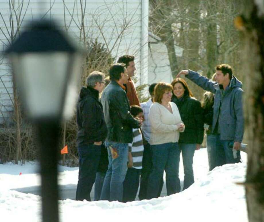 Ty Pennington, right, speaks with Debbie Oatman outside her home on Thursday, March 22. Photo: Paul Buckowski