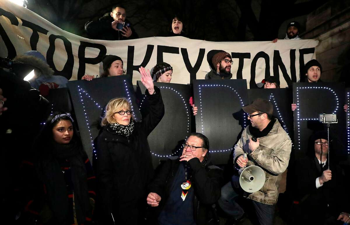 In this file photo taken on January 24, 2017 US actress and political activist Jane Fonda (2nd L) attends a rally with opponents of the Keystone XL and Dakota Access pipelines as they protest US President Donald Trump's executive orders advancing their construction, at Columbus Circle in New York on January 24, 2017. - Judge Brian Morris of the US District Court for the District of Montana on November 8, 2018, halted construction of the Keystone XL oil pipeline, arguing that President Donald Trump's administration had failed to adequately explain why it had lifted a ban on the project. (Photo by JASON SZENES / AFP)JASON SZENES/AFP/Getty Images