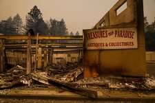 A destroyed antique shop is seen off of Skyway after the Camp Fire tore through the town of Paradise, California, on Friday, Nov. 9, 2018.