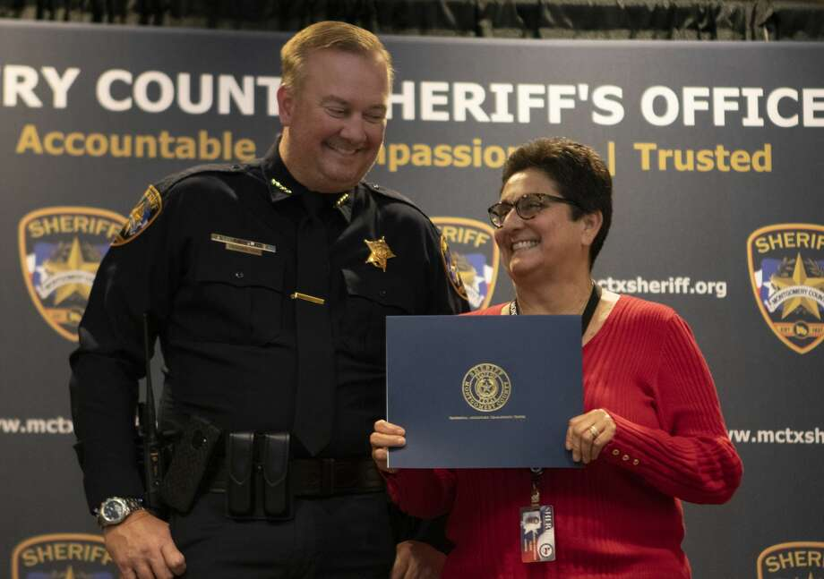 Clerk Deborah Thompson and sheriff Rand Henderson smile after Thompson was given the Accountable Award during the Montgomery County Sheriff's Office Promotion and Awards Ceremony on Thursday, Nov. 8, 2018 at the Lonestar Convention Center in Conroe. Photo: Cody Bahn/Staff Photographer