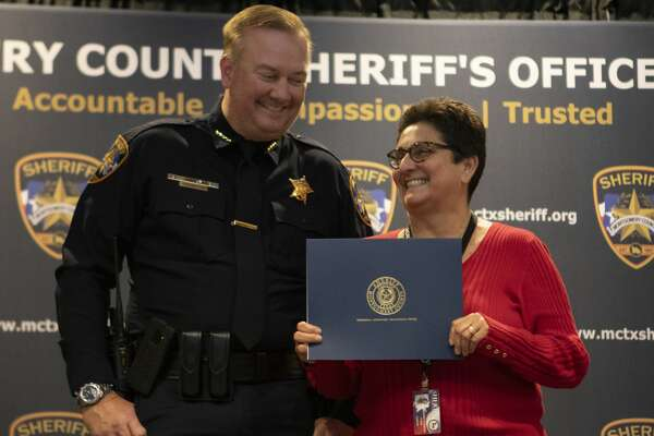 Clerk Deborah Thompson and sheriff Rand Henderson smile after Thompson was given the Accountable Award during the Montgomery County Sheriff?'s Office Promotion and Awards Ceremony on Thursday, Nov. 8, 2018 at the Lonestar Convention Center in Conroe.