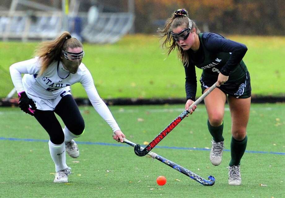 Staples' Kyle Kirby, left, and Norwalk's Julia Vaccaro chase the ball during Friday's CIAC Class L quarterfinal in Westport. The Wreckers won 1-0 and will meet Photo: Christian Abraham / Hearst Connecticut Media / Connecticut Post