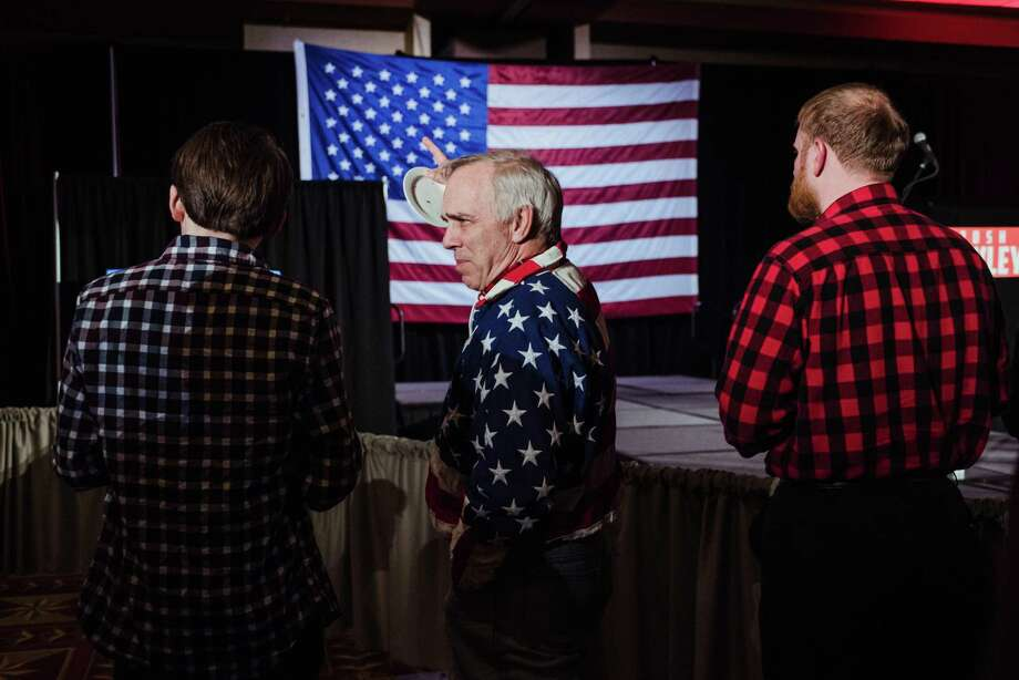 A man wears a patriotic jacket at the election party for Josh Hawley, a Republican candidate for Senate, at the University Plaza Convention Center in Springfield, Mo., Tuesday. Voter turnout exceeded expectations but some of the campaigns continued to foment division and falsehoods. Photo: RYAN CHRISTOPHER JONES /NYT / NYTNS