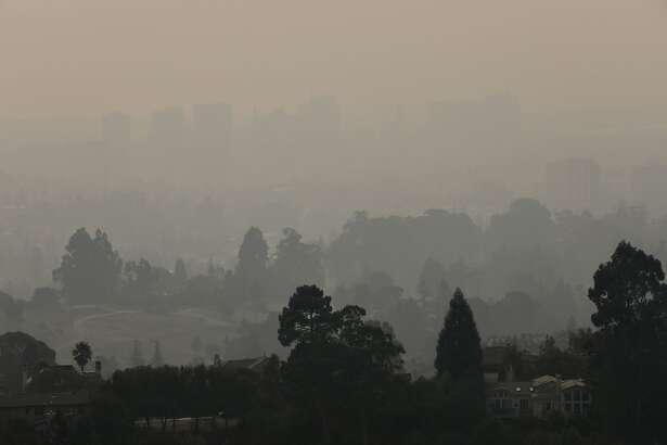 Smoky air fills the sky in Oakland, the view seen from Hiller Highlands, in Oakland, Calif. on Friday, November 9, 2018.