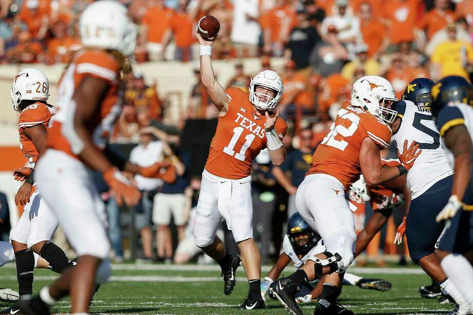 PHOTOS: College football coaches salary (2018)   AUSTIN, TX - NOVEMBER 03: Sam Ehlinger #11 of the Texas Longhorns throws a pass in the first half against the West Virginia Mountaineers at Darrell K Royal-Texas Memorial Stadium on November 3, 2018 in Austin, Texas.   >>>Browse through the gallery for a look at college football coaches' salaries in 2018 ...  Photo: Getty Images / 2018 Getty Images