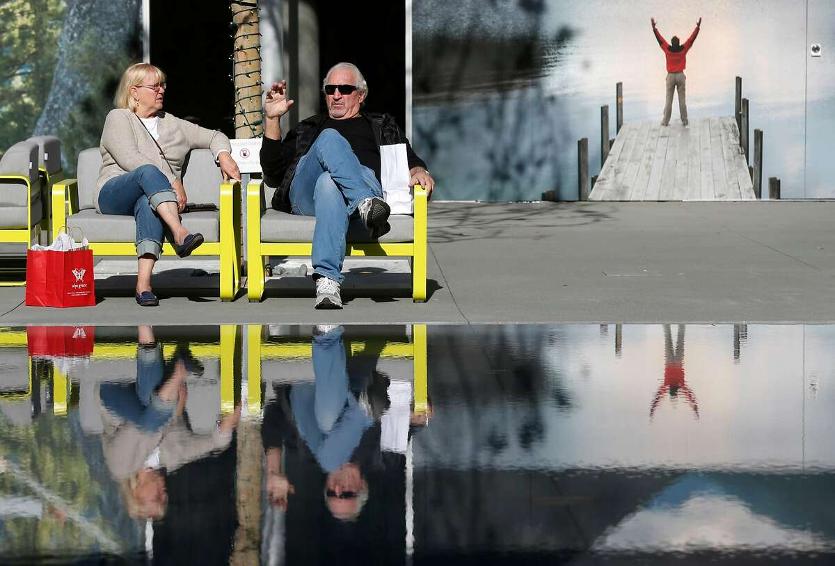 Claire and Robert Ellis relax near a fountain in the courtyard while shopping at the new City Center Bishop Ranch outdoor shopping mall in San Ramon, Calif. on Thursday, Nov. 8, 2018.
