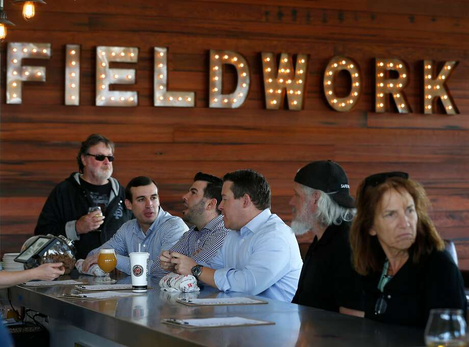 Beer lovers crowd into a Fieldwork Brewing Co. taproom on the opening day of the new City Center Bishop Ranch outdoor shopping mall in San Ramon, Calif. on Thursday, Nov. 8, 2018. Photo: Paul Chinn / The Chronicle
