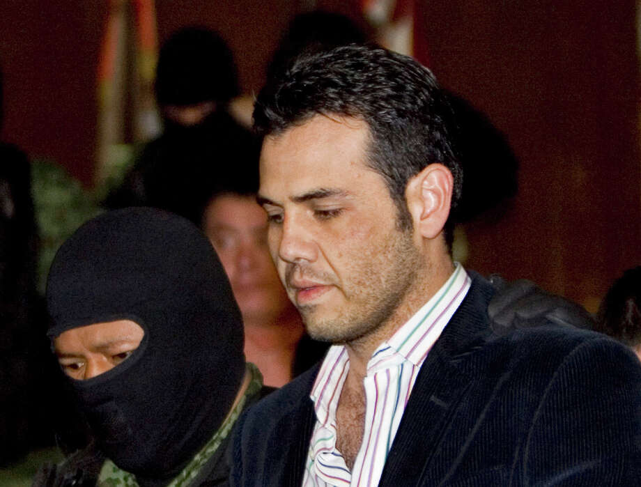 """FILE - In this March 19, 2009 file photo, military officers escort alleged drug trafficker Vicente Zambada during his presentation to the media in Mexico City. Zambada, a former top lieutenant to Joaquin """"El Chapo"""" Guzman and likely witness at the Mexican drug lord's New York trial, has pleaded guilty to trafficking conspiracy in Chicago, saying in a plea agreement unsealed Friday, Nov. 9, 2018, that he will cooperate with prosecutors in hopes of a reduced sentence and protection from cartel retribution for his family. Photo: Eduardo Verdugo, AP / Copyright 2018 The Associated Press. All rights reserved."""
