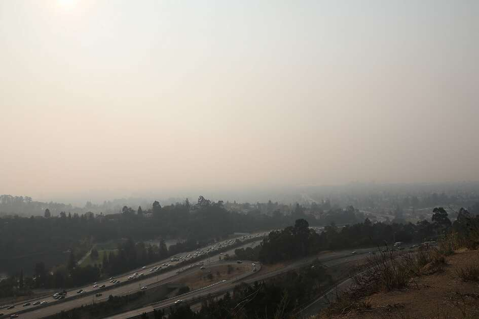 Smoky air fills the Oakland sky with a view from Hiller Ave. in Oakland, Calif. on Friday, November 9, 2018.
