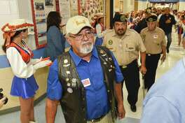 Veterans make their way to the Trautmann Middle School gym in 2016 for the Veteran's Day Ceremony where students honor those who have served in the military.