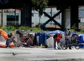 "Residents and visitors of the large encampment at Fifth and Bryant Streets cheered the new legislation but found little chance of it passing and helping their situation Wednesday April 8, 2015. Southern California State Senator Carol Liu has introduced legislation to create a ""right to rest"" law which would wipe out San Francisco's sit-lie law and legalize tent camps."