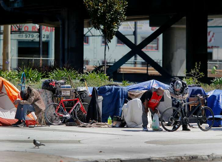 """Residents and visitors of the large encampment at Fifth and Bryant Streets cheered the new legislation but found little chance of it passing and helping their situation Wednesday April 8, 2015. Southern California State Senator Carol Liu has introduced legislation to create a """"right to rest"""" law which would wipe out San Francisco's sit-lie law and legalize tent camps."""