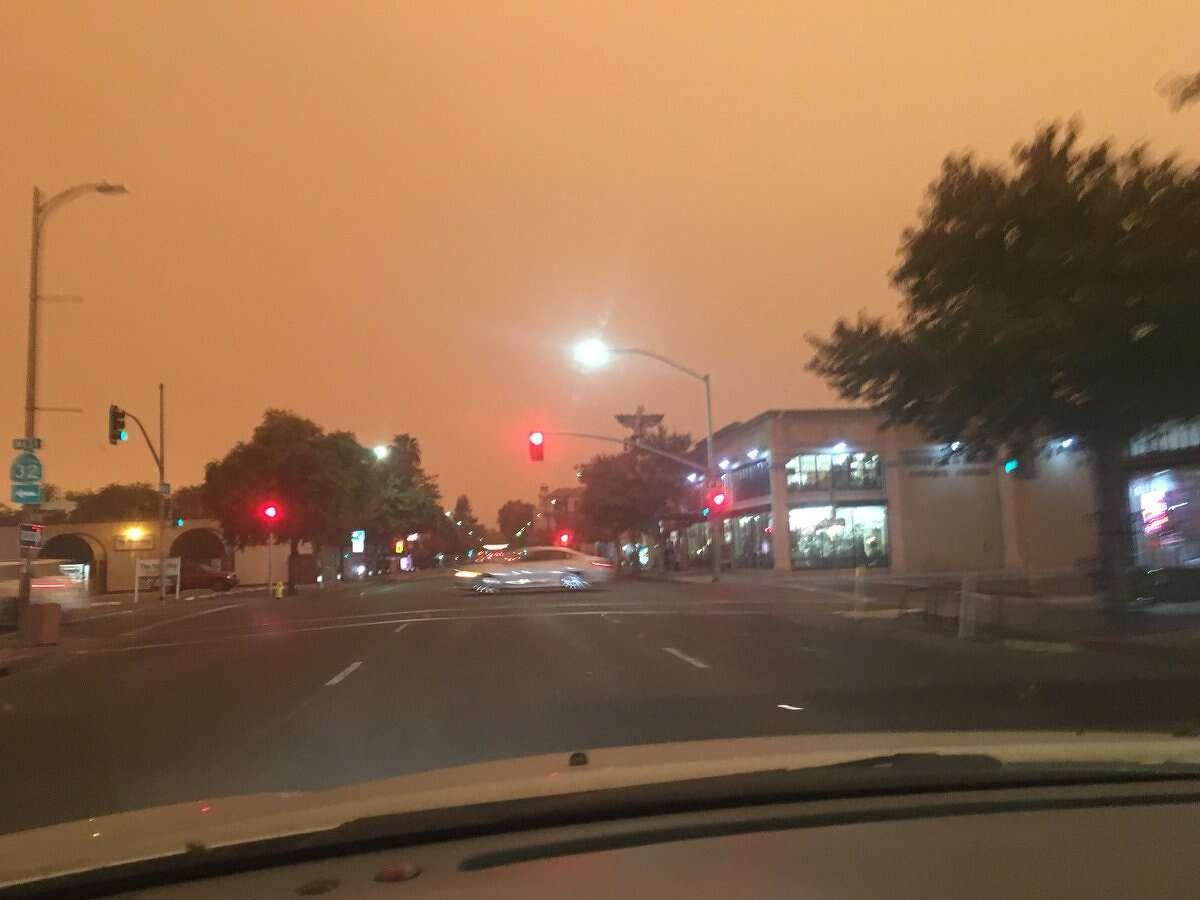Photos of Chico taken Friday afternoon showed a dark sky, choked by smoke from the nearby Camp Fire.