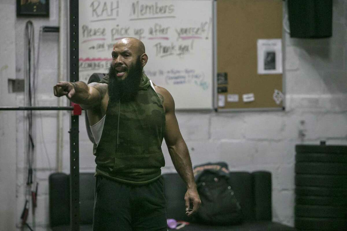 Jose Sanchez calls out instructions during a class held at Rise Above Hardship gym. Sanchez is a retired vet who lost a leg in Afghanistan and has since opened a gym to help other vets and community members get in shape.