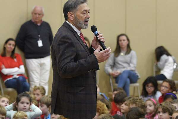 Interim Superintendent of Schools Ralph Mayo speaks at the Veterans Day ceremony at Riverside School in the Riverside section of Greenwich, Conn. Friday, Nov. 9, 2018. The ceremony featured a slideshow and musical performances to honor veterans, including the late Nick Mecca, a longtime Riverside resident and school crossing guard.