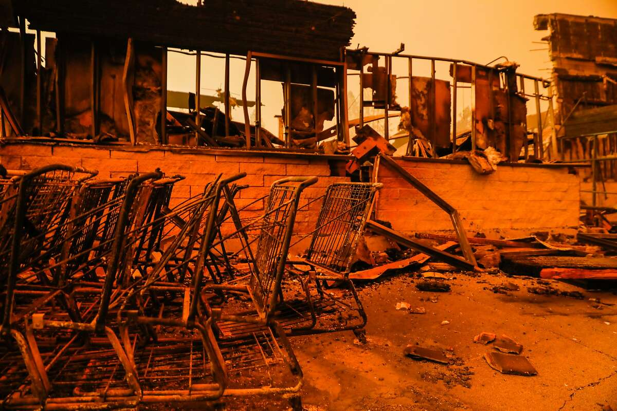 Safeway shopping carts are seen destroyed off of Clark Road after the Camp Fire tore through the town of Paradise, California, on Friday, Nov. 9, 2018.