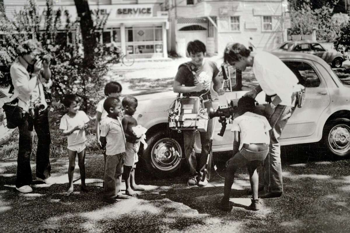 Undated photo of NBC cameraman Bob Brown in Georgetown, the capital of Guyana, showing local children his camera. Connie Brown Henderson is the widow of Bob Brown, the veteran NBC cameraman who was shot to death in 1978 at Jonestown along with Congressman Leo Ryan and three others as they tried to leave with defectors from the cult -- Brown kept filming even as he was shot. She and Brown were married years before, but they had to move to San Francisco because he was black and she was white and their union was illegal in Indiana where they lived.