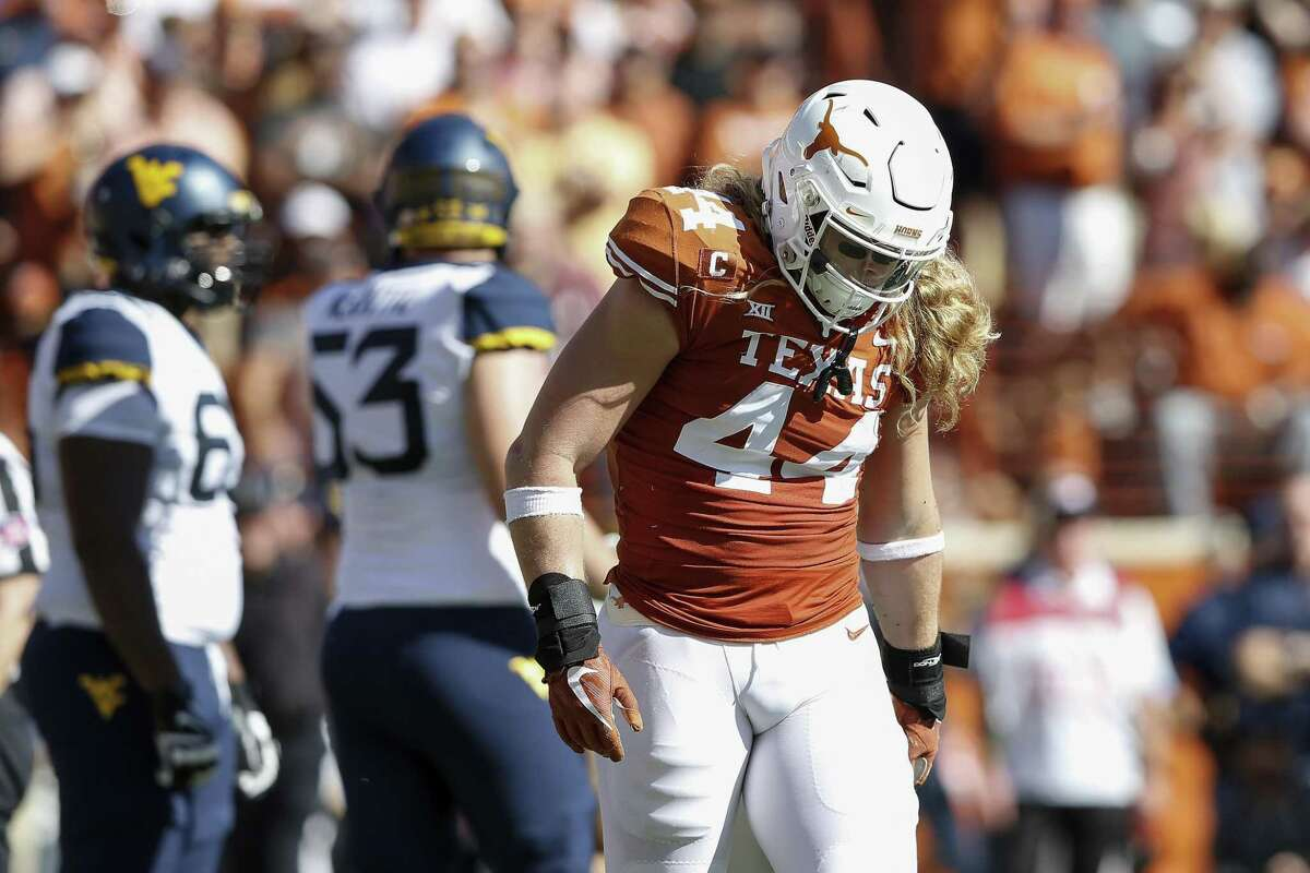 AUSTIN, TX - NOVEMBER 03: Breckyn Hager #44 of the Texas Longhorns walks toward the sideline after an injury to his arm in the first half against the West Virginia Mountaineers at Darrell K Royal-Texas Memorial Stadium on November 3, 2018 in Austin, Texas. (Photo by Tim Warner/Getty Images)