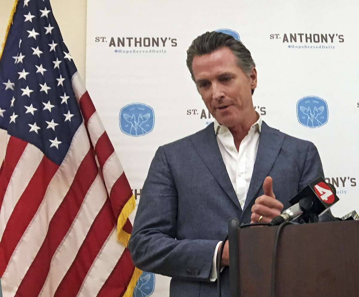 California Gov.-elect Gavin Newsom makes his first public comments after his election in San Francisco Thursday, Nov. 8, 2018.. Newsom condemned the politicians and gun advocates who he says have normalized mass shootings in America. He was scheduled to make his first public remarks after winning office Tuesday, but he dedicated much of his time Thursday to the shooting in a country music bar in Southern California. (AP Photo/Janie Har)
