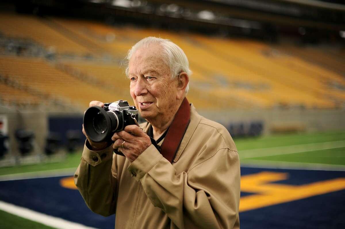 Photographer Bob Stinnett stands in Memorial Stadium on Thursday, Oct. 4, 2012, in Berkeley, Calif. Stinnett used the Nikon FM2 camera he is holding to photograph