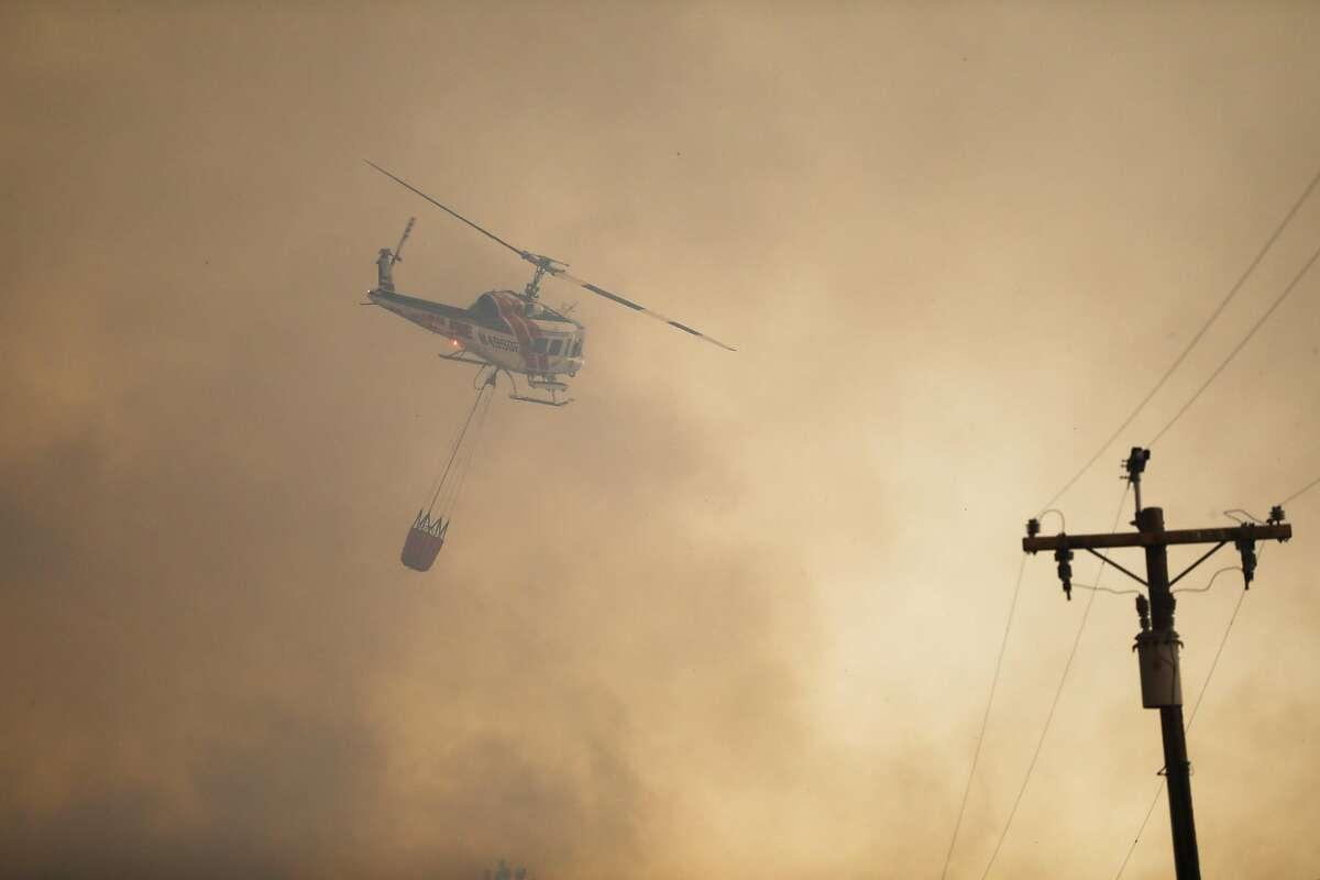 Camp Fire burns off of Pentz Road in Paradise, California, on Thursday, Nov. 8, 2018.