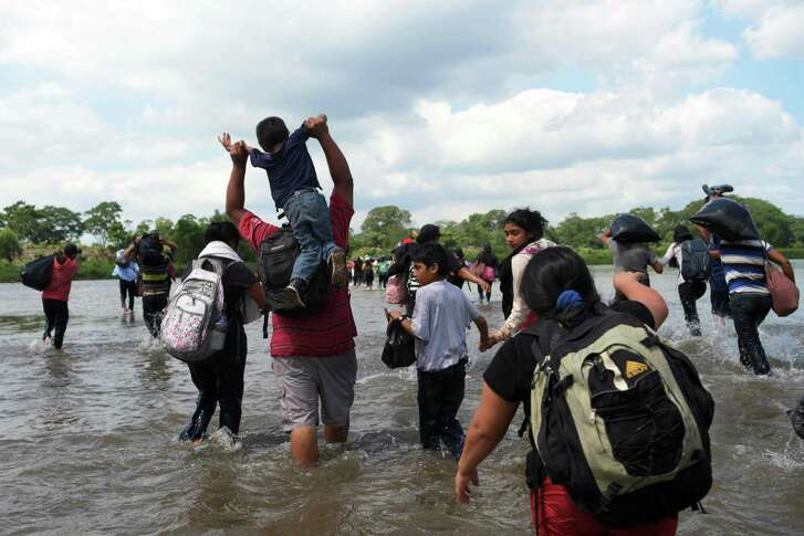 Salvadorean migrants heading in a caravan to the United States, cross the Suchiate River to Mexico, as seen from Ciudad Tecun Uman, Guatemala, on November 02, 2018.