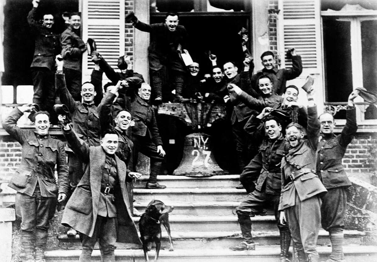 In this Nov. 1918 file photo, American soldiers from New York, who served on the frontline in Cambria, France, rig up a Liberty Bell to celebrate the signing of the Armistice to end World War One. (AP Photo, File)