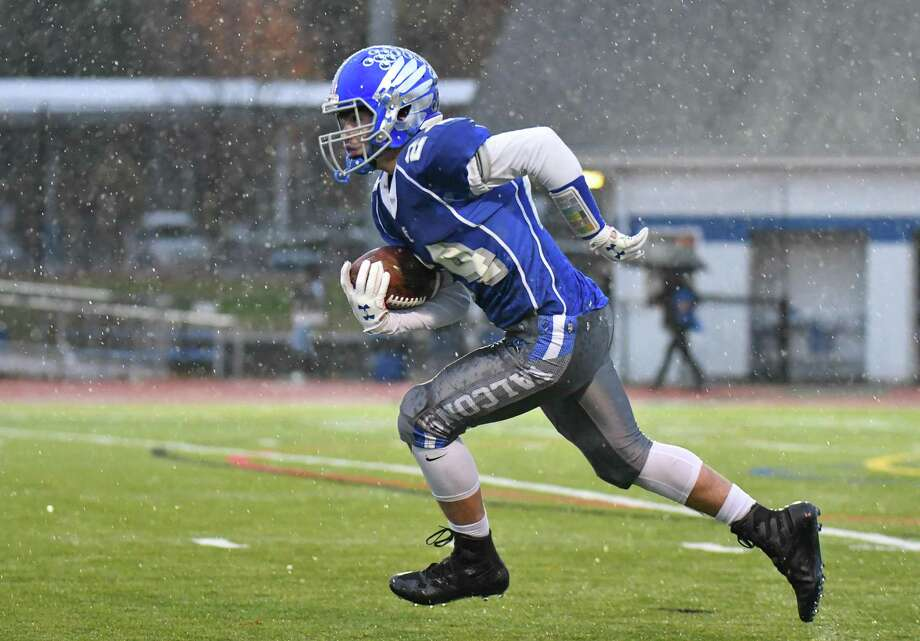 James Bourque (24) of the Fairfield Ludlowe Falcons handles the initial kick off during a game against the New Canaan Rams on Friday November 9, 2018 at Fairfield Ludlowe High School in Fairfield, Connecticut. Photo: Gregory Vasil / For Hearst Connecticut Media / Connecticut Post Freelance