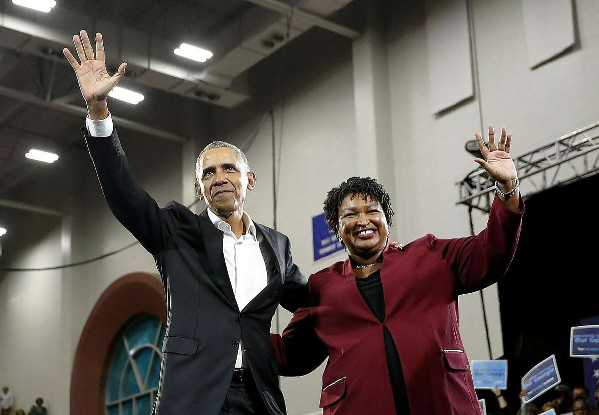 Former President Barack Obama and Democratic candidate for Georgia Goveernor Stacey Abrams wave to the crowd during a campaign rally at Morehouse College Friday, Nov. 2, 2018, in Atlanta. (AP Photo/John Bazemore)