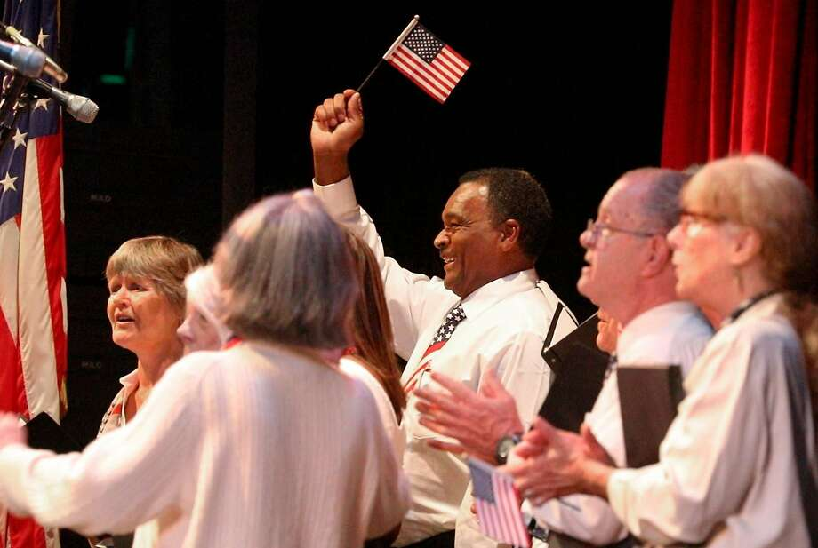 Christopher Poston celebrates with Tosca at a naturalization service. Photo: Lea Suzuki / The Chronicle