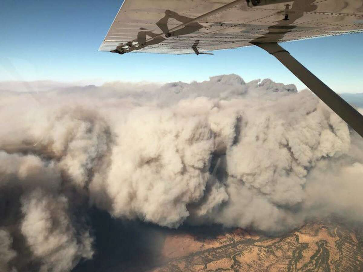 View of a wall of smoke created by the Camp Fire in Butte County.CHP Air Operations flew missions in difficult conditions on Friday to support of first responders and citizens in need.