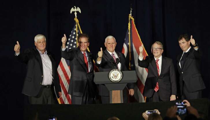 U.S. Reps. Bob Gibbs and Jim Renacci, Vice President Mike Pence, gubernatorial candidate Mike DeWine and U.S. Rep. Troy Balderson hold up a thumbs up at a campaign event in Mansfield, Ohio, at the Mansfield Lahm Regional Airport on Oct. 31, 2018.