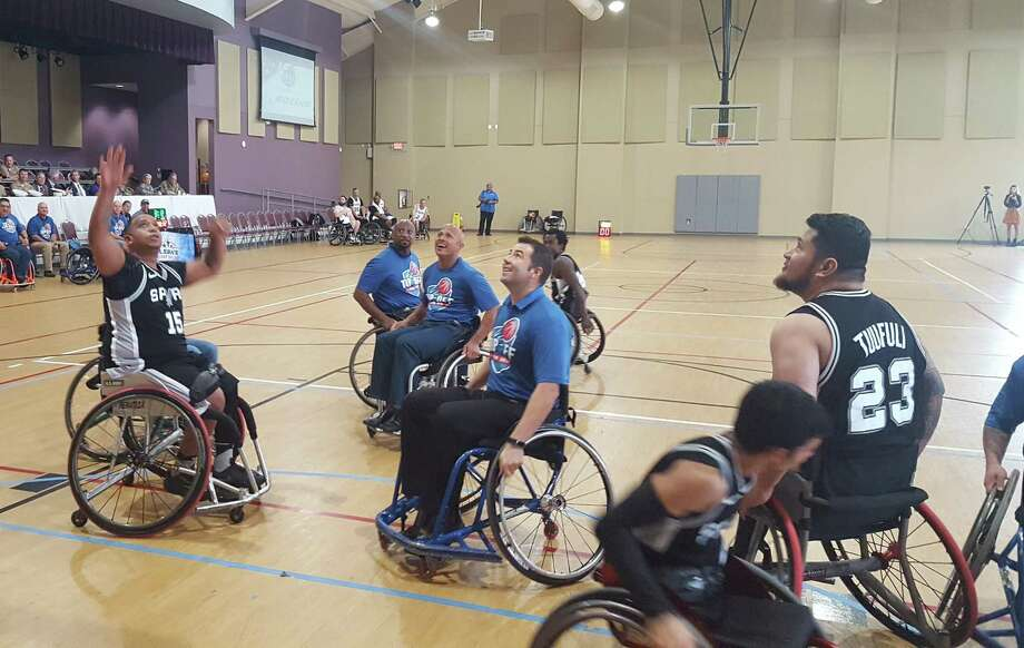"Nakia Merritte (15), team captain for the San Antonio Parasports Wheelchair Basketball team, launches a shot over several Boeing Inc.-San Antonio opponents. The Oct. 31 game at Morgan's Wonderland tipped off San Antonio's ""Celebrating America's Military"" events through Nov. 14. Photo: Jeff B. Flinn / Staff Photographer"