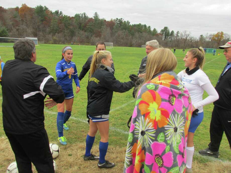 East Hampton battled through the rain for a Class S girls soccer quarterfinal win over Housatonic Friday afternoon at Housatonic High School. Photo: Peter Wallace /For Hearst Connecticut Media