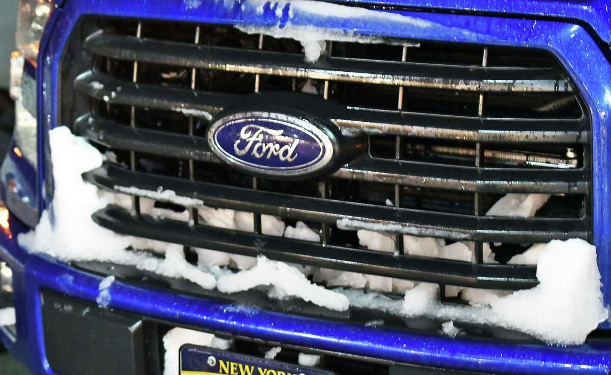 Snow packs the grill of a pick up truck in the parking lot of the Glens Falls-Beekmantown football game Friday night in Clifton Park, NY. (John Carl D'Annibale/Times Union)