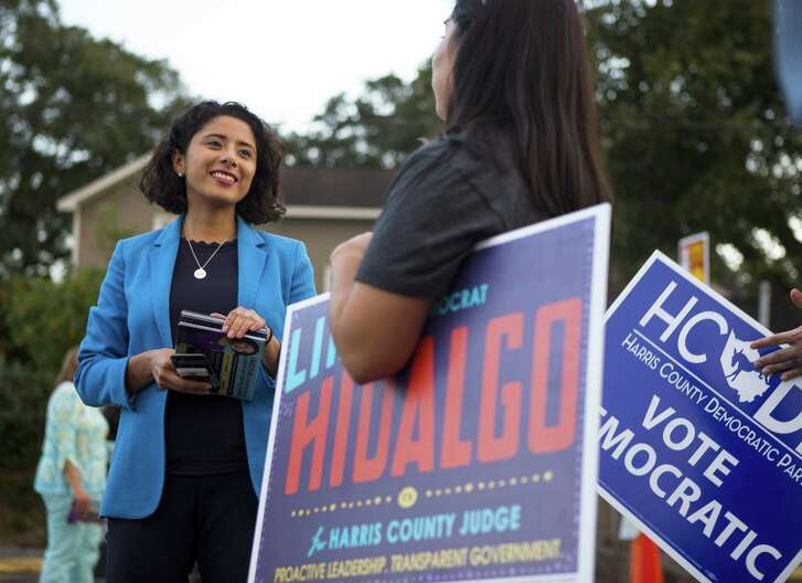 Lina Hidalgo talks with campaign volunteers outside of a polling place located at the SPJST Lodge 88 in the Heights, on Election Day, Nov. 6, 2018 in Houston. Hidalgo, a Democrat making her first run for office, defeated incumbent Republican Ed Emmett.